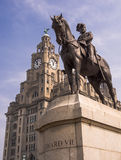 King Edward VII and Liver Building, Liverpool. Statue of Edward VII, King of the United Kingdom, with the Liver Building behind. Liverpool, UK royalty free stock photo