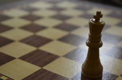 King on an empty chess board stock photography