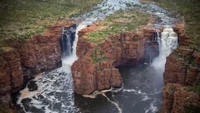 King George River - Northern Kimberley. The mighty King George River falls off the Kimberley Plateau with a thunderous roar directly into the ocean far below. A stock photography