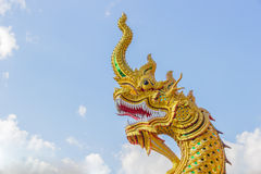 King of gold Nagas. Statue of King of gold Nagas in thailand Stock Photography