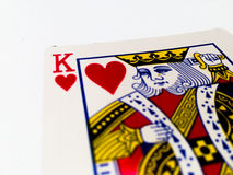 King Hearts Card with White Background. A playing card is a piece of specially prepared heavy paper, thin cardboard, plastic-coated paper, cotton-paper blend, or Royalty Free Stock Photos