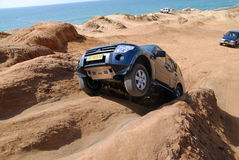 King of the hill. A Mitsubishi Pajero King on a cliff ride Stock Photo