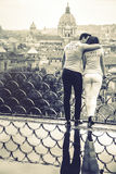 The king, his queen. Romantic couple in Rome, Italy. Black and white. Two young people, a men and a women are kissing and loving. On a terrace with railing Royalty Free Stock Photo