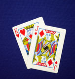 King Jack. Playing cards king jack (in poker that hand names King James) on blue cloth Royalty Free Stock Photography