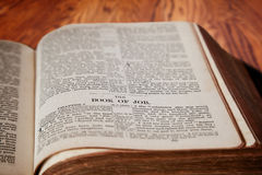 King James Bible Book of Job on Rustic Wooden Background Stock Photos