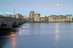 King John castle in Limerick. At dusk with full moon- Ireland Royalty Free Stock Images