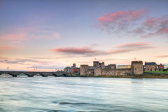 King John Castle at sunset. King John Castle and old bridge at sunset, Limerick, Ireland Royalty Free Stock Photography