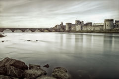 King John's Castle in Limerick, Ireland.B&w photo. King John's Castle is a castle located on King's Island in Limerick, Ireland, next to the River Shannon.Black stock photo