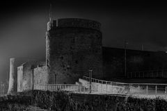 King John's Castle. 's walls at night.  The castle in Limerick and on the banks of the River Shannon has massive stone walls that held during the famous siege of Royalty Free Stock Photo