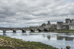 King Johns Castle and an old bridge. Over river Shannon, Limerick, Ireland Stock Image