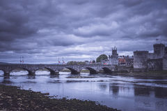 King Johns Castle and an old bridge. Over river Shannon at night, Limerick, Ireland Stock Photos