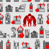 King Kong Ruined building seamless pattern. Dangerous Big Gorill. A broke city. Destroyed buildings. Angry Monkey and fire in houses Stock Photography