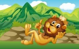 A king lion across the mountain Royalty Free Stock Photo