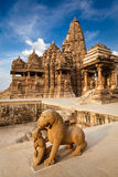 King and lion fight statue. And Kandariya Mahadev temple. Khajuraho, India stock photo