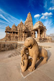 King and lion fight statue and Kandariya temple Stock Images
