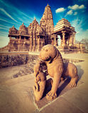 King and lion statue, Kandariya Mahadev temple Royalty Free Stock Photo