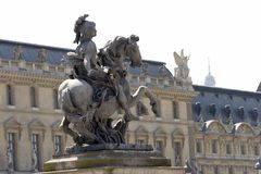 King Louis Statue. Statue in Louvre's yard stock photo