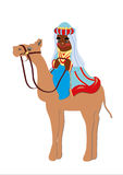 King magus camel. Black man, wearing traditional dress, a symbol of the epiphany, shown on a white background Stock Photo