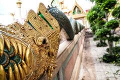 King of Nagas golden buddha statue. Thai golden buddha statue in temple Royalty Free Stock Image