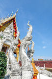 King of Nagas statue with temple background Royalty Free Stock Photography