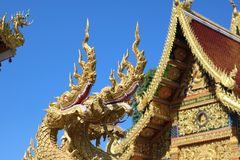 King of Nagas statue and Wat in Thailand. Royalty Free Stock Image