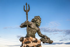 King Neptune Statue at Virginia Beach. King Neptune statute,  famous tourist attraction at Virginia Beach against a blue sky in summer Stock Image