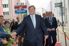 King of the Netherlands. ENSCHEDE, THE NETHERLANDS - SEPT 03, 2015: King Willem Alexander from The Netherlands is shaking hands with people while he is going to Stock Image