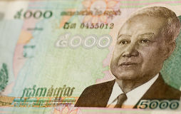 King Norodom Sihanouk Cambodia banknote. Angled view, with selective focus, of a 5000 Riel banknote from Cambodia.  King Norodom Sihanouk on a green background Royalty Free Stock Photo