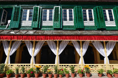 King palace with green shutters and flower pots. Durbar square, Stock Images
