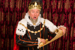 King with parchment scroll Stock Photo