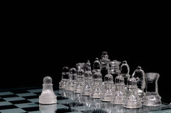 King and pawn. Glass chess figures in order ,against the pawn Royalty Free Stock Images