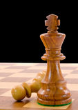 King and pawn. Chess pieces on black background Stock Photos