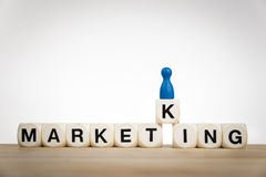 King pawn on the word Marketing Stock Image