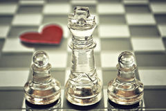 King and pawns on chess board Royalty Free Stock Photos