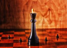 King and pawns. On the chessboard, chess can be compared to real life, there are managers, and there are promoted, big companies and small Royalty Free Stock Image