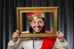 King with picture frame Stock Image