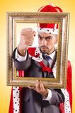 King with picture frame Royalty Free Stock Photography