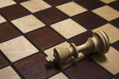 King piece down in chess game Royalty Free Stock Photos