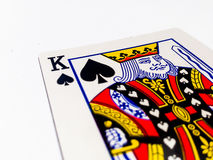 King Pikes / Spades Card with White Background. A playing card is a piece of specially prepared heavy paper, thin cardboard, plastic-coated paper, cotton-paper Stock Image