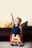 King of the potty. Baby boy toddler sitting on the potty stock image
