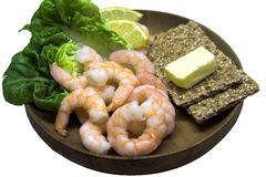 King Prawn Platter. Wooden platter with king prawns, lemon, lettuce and crispbread with butter Stock Photography