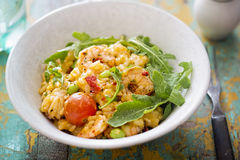 King prawn risotto with tomatoes Stock Image