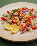 King prawns with brown rice Stock Images