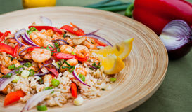King prawns with brown rice Stock Photo