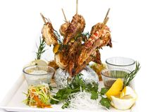 King prawns cooked on wooden skewers. Serving with sauces and he royalty free stock photography
