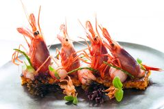 King prawns with crisp seafood rice. Royalty Free Stock Images