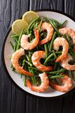 King prawns with green beans, cheese and lemon close-up on a pla Royalty Free Stock Images