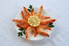 King prawns with lemon, Andalusia, Spain. King prawns with fresh lemon and parsley tapas, Costa del Sol, Malaga Province, Andalusia, Spain, Western Europe Royalty Free Stock Images