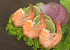 King Prawns on Limes and Lettuce Royalty Free Stock Photography