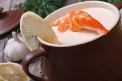 King prawns soup with lemon Royalty Free Stock Photos